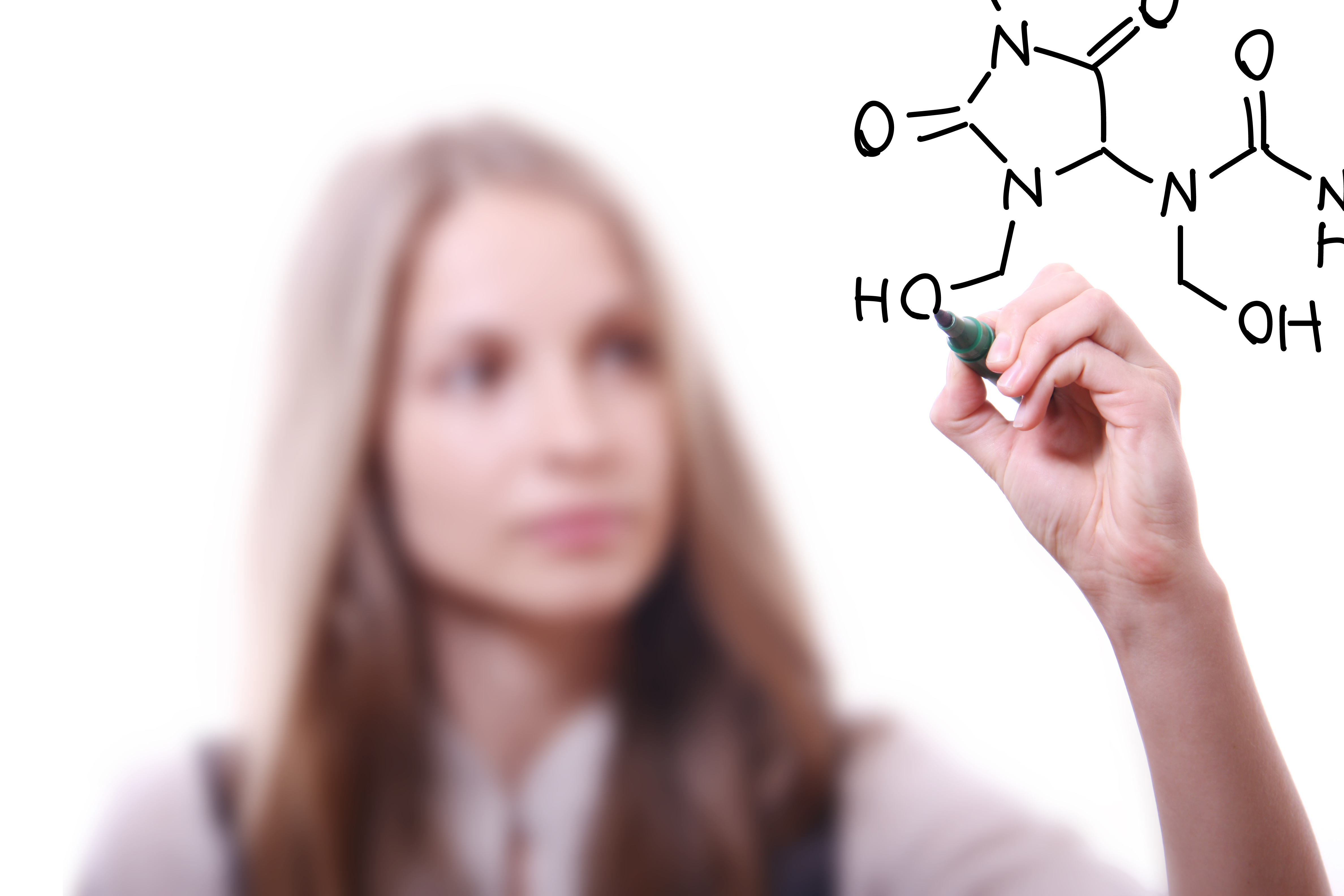 woman chemist shows a molecular structure
